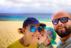 Happy family on the beach on Bonaire island