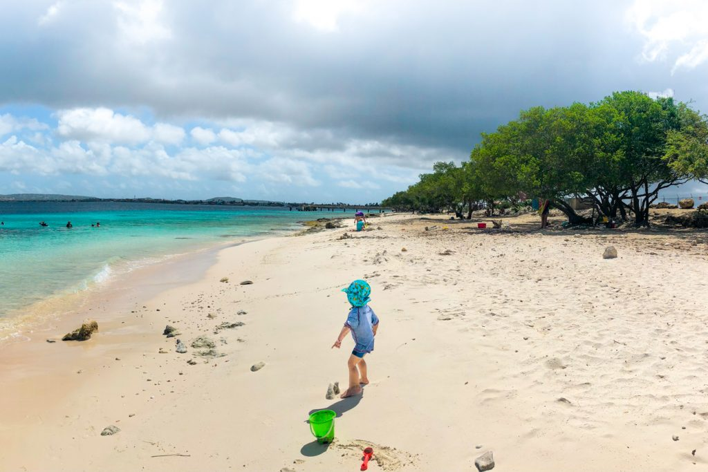 Kid playing on the beach in Bonaire