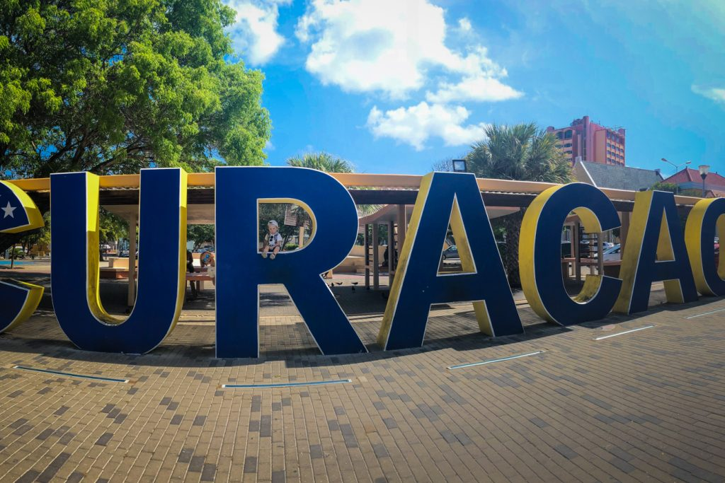 visit Curacao sign