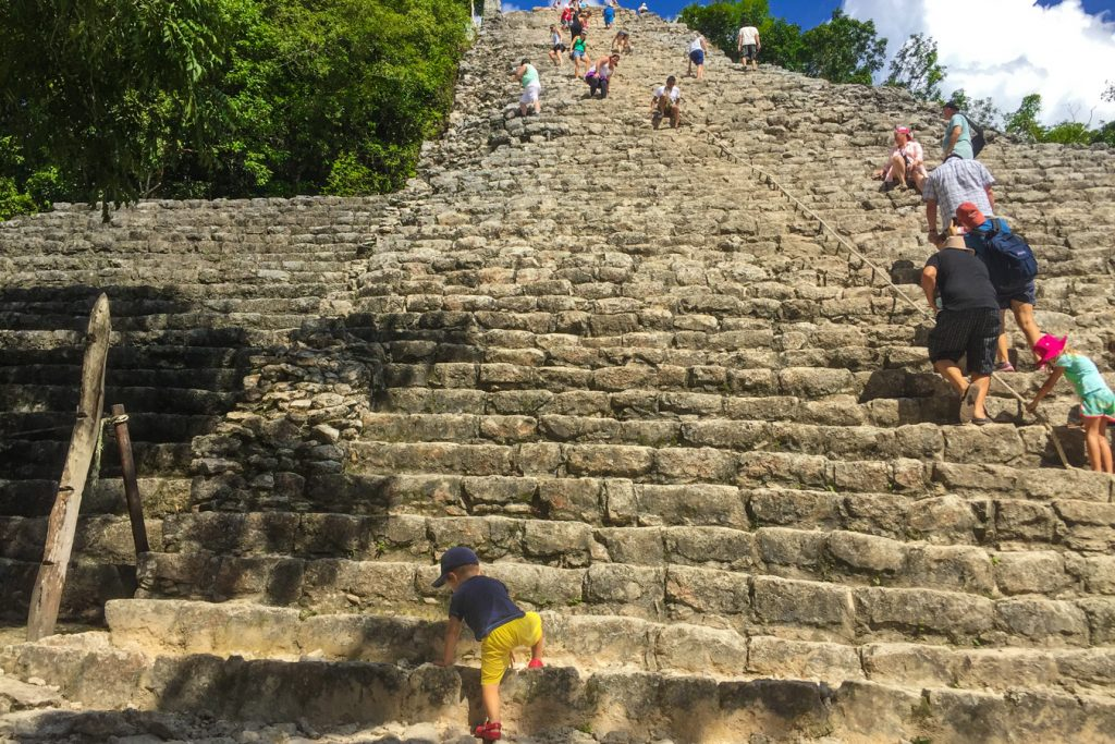 Coba pyramid with a toddler